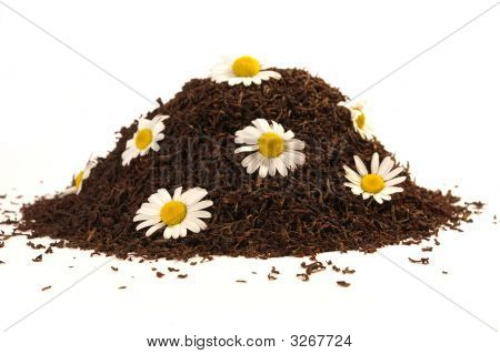 Heap Of Black Tea And Chamomile