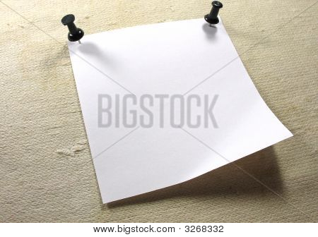 White Notice Paper Over A Old Canvas Background