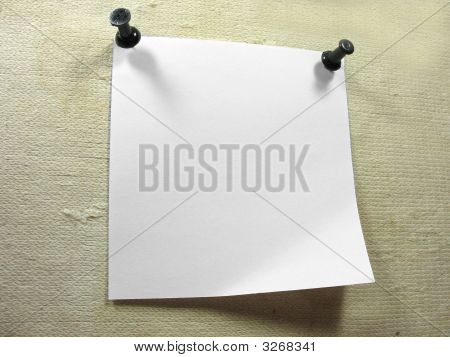 White Piece Of Notice Paper Over A Canvas Background