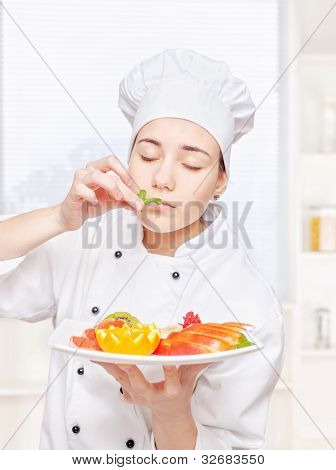 Chef Smell Mint Before Putting It On A Plate Of Fruit