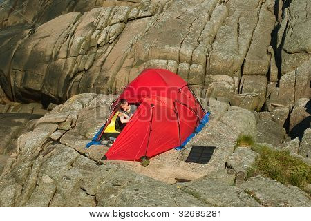 Young Woman Camping on Rocks