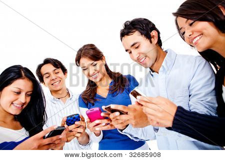 Group of young people texting on their cell phones - isolated over white