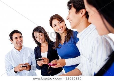 Group of friends texting on their mobile phones - isolated over a white background