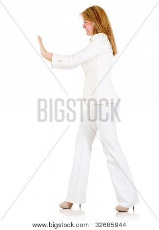 geschäftsfrau drängen etwas isoliert auf weißem Hintergrund