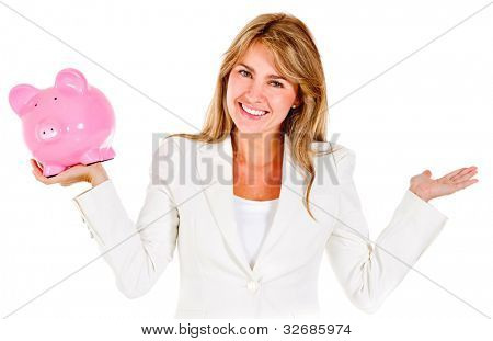 Businesswoman holding a piggybank and compering it to something - isolated over white