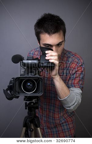 Young Man With Professional Video Camcorder