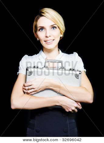Business Woman Clutching A Metal Briefcase