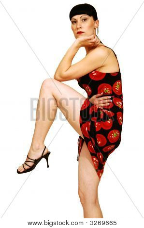 Standing Woman In Tomato Dress.