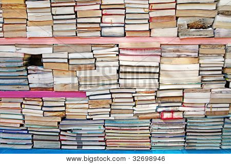 A stack of old wet and damaged used books.