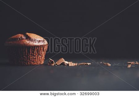 A yummy Chocolate cupcake and chocolate shavings