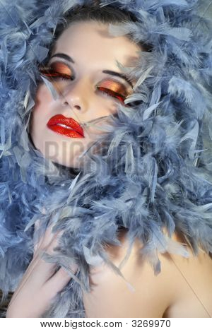 Woman In Feathers With Long Lashes