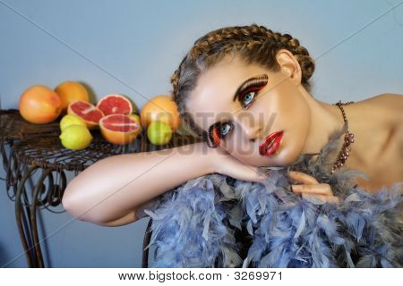 Beautiful Woman With Feathers And Fruit