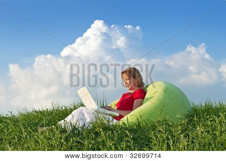 Woman With Laptop Computer Outdoors