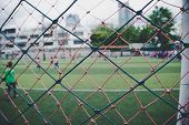 Youth Soccer Match League Tournament In A Small Soccer Pitch Blurred Behind The Net. Your Football C poster
