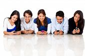 image of cell  - Group of people texting on their cell phones  - JPG