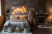 Cosy Bedroom With Eco Decor. Wood And Nature Concept In Interior Of Room. Scandinavian Interior With poster