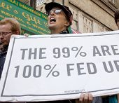NEW YORK - MAY 1: A protester holds a sign that reads 'The 99% Are 100% Fed Up ' during the march to