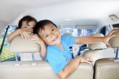 stock photo of road trip  - Asian children ready for a road trip posing in car - JPG