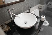 Bathroom Interior With White Round Sink And Chrome Faucet In A Modern Bathroom. Water Flowing From T poster