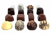 image of sweet sixteen  - Sixteen luxury chocolates in rows on white background - JPG