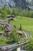 Train In Lauterbrunnen Valley, Switzerland. Idyllic Landscape poster