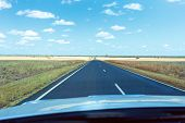 A Long Straight Australian Country Road Stretching Into The Distance Seen Through A Moving Car Winds poster