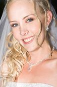 image of blue eyes  - Beautiful Blond bride wearing diamond jewelery and a veil - JPG