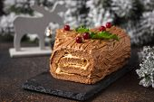 Christmas Yule Log Cake. Traditional Chocolate Dessert On Festive Background poster