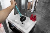 Sink Repair By Hand With A Toilet Plunger. Plumbing. A Plumber Uses A Plunger To Unclog A Sink. Toil poster