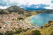 Panoramic view of Copacabana Bay on Titicaca Lake from the summit of Mount Calvario (3966 m) among t poster