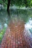 Flooded Red Brick Walkway, Reiny Cloudy Day poster