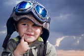 Adorable baby dressed in pilot uniform with funny face