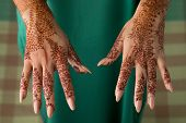 Moroccan woman showing the upside of traditional henna painted hands  poster
