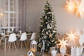 Christmas Decorated Kitchen And Living Room Interior In Scandinavian Style With Christmas Tree. Cozy poster