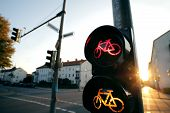 Wide Angle View On A Traffic Light For A Cycling Lane Showing Red And Yellow Bicycle Symbols In Brig poster