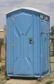 stock photo of porta-potties  - This portable outhouse is placed on rural property.