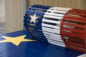stock photo of acadian  - A lobster trap with the Acadian flag painted on it - JPG