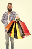 The Bags Are Full. Happy Hipster Shopper Holding Shopping Bags Isolated On White. Bearded Man Smilin poster