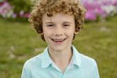 Cool Portrait Of The Redhead Little Boy With Sincere Emotions And Cool Healthy Smile. Natural Behavi poster