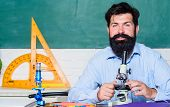 Fascinating Research. Set Up Microscope. Teacher Sit Desk With Microscope. Man Bearded Hipster Class poster