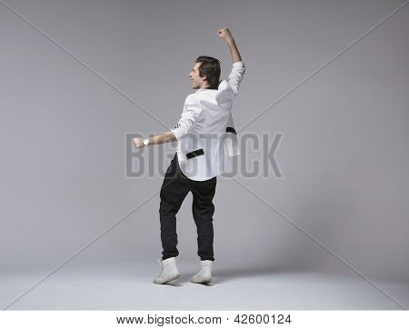 Business man jumping in joy on white background