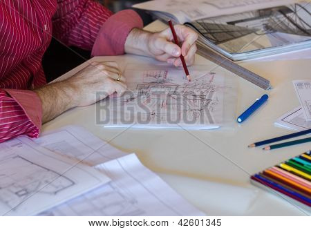 Architect Or Business Young Man Drawing Sketch Of Modern House