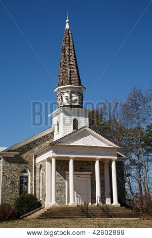 Old Stone Church With White Wood Face