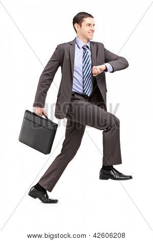 Full length portrait of a businessman climbing a virtual staircase isolated on white background