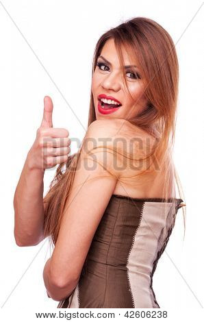 Beautiful long hair brunette in the corset, showing thumbs up - isolated on white