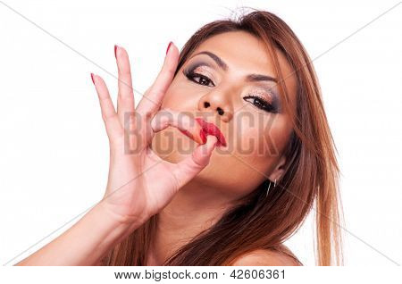 Beautiful brunette showing ok sign, isolated on white