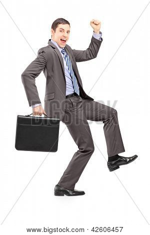 Full length portrait of an excited businessman with a briefcase gesturing happiness isolated on white