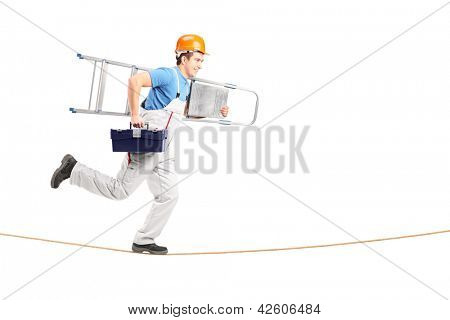 Full length portrait of a repairman running on a rope with a ladder and a tool box isolated on white background