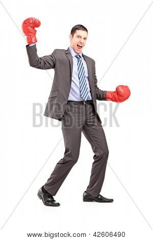 Full length portrait of a businessman wearing red boxing gloves and gesturing happiness isolated on white background
