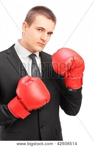 Young man in suit with red boxing gloves ready to fight isolated on white background